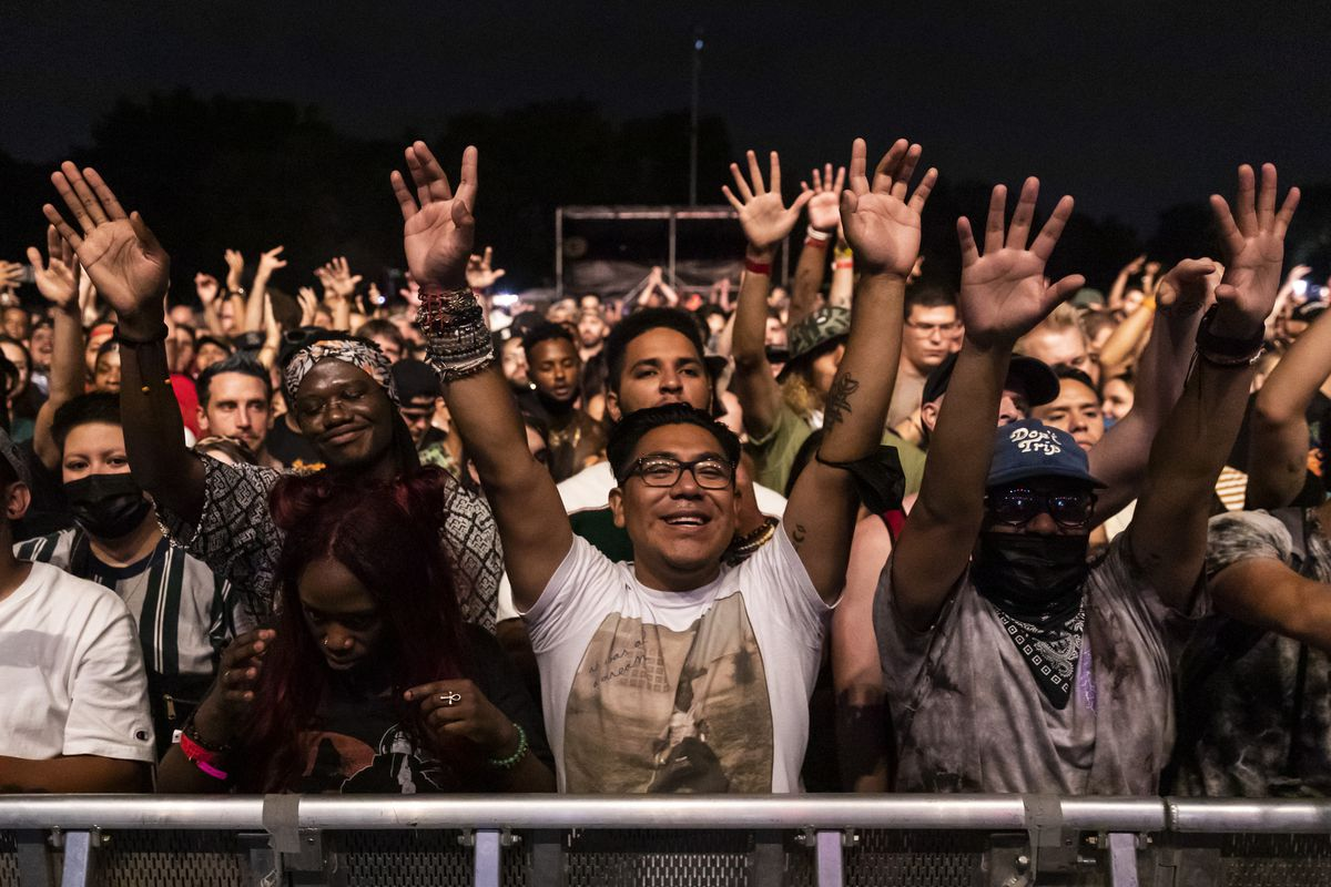 Fans cheer as Lupe Fiasco performs Friday night at Riot Fest in Douglass Park.