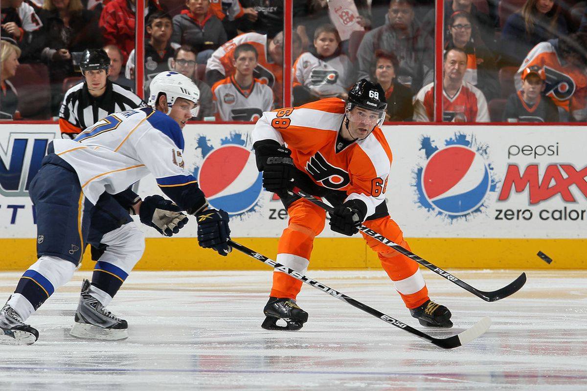 PHILADELPHIA, PA - OCTOBER 22: Jaromir Jagr #68 of the Philadelphia Flyers clears the puck from Vladimir Sobotka #17 of the St. Louis Blues on October 22, 2011 at Wells Fargo Center in Philadelphia, Pennsylvania.  (Photo by Jim McIsaac/Getty Images)