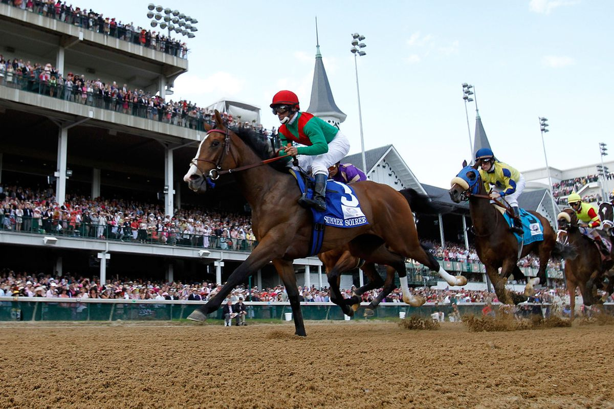 LOUISVILLE, KY - MAY 06:   Jockey Gabriel Saez, riding Summer Soiree, leads the field down the front stretch at the start of the 137th Kentucky Oaks at Churchill Downs on May 6, 2011 in Louisville, Kentucky.  (Photo by Rob Carr/Getty Images)