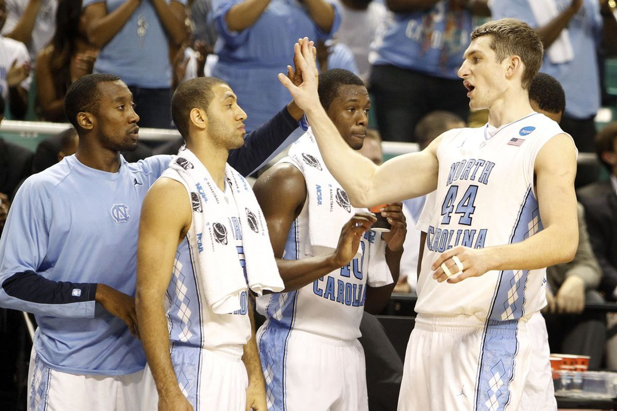 Justin Watts (24) and Kendall Marshall (5) and forwards Harrison Barnes (40) and Tyler Zeller (44) react toward the end of a 2012 NCAA men's basketball tournament game at Greensboro Coliseum.  The Tar Heels defeated the Blue Jays 87-73.