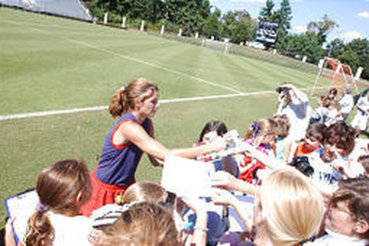 Mia Hamm, a forward on the Women's National Soccer Team, signs autographs after a practice session Wednesday.