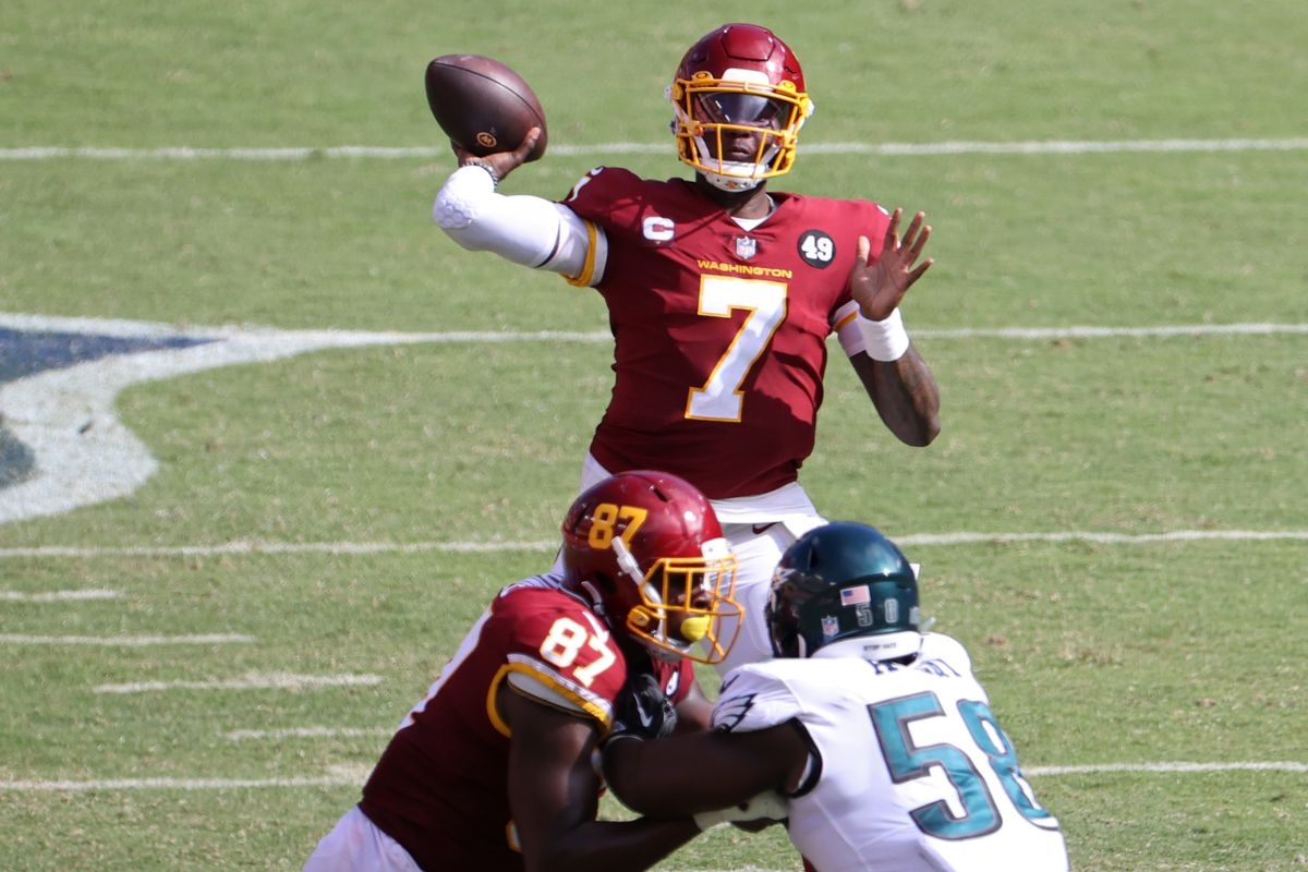Washington Football Team quarterback Dwayne Haskins Jr. passes the ball as Philadelphia Eagles defensive end Genard Avery (58) defends in the fourth quarter at FedExField.
