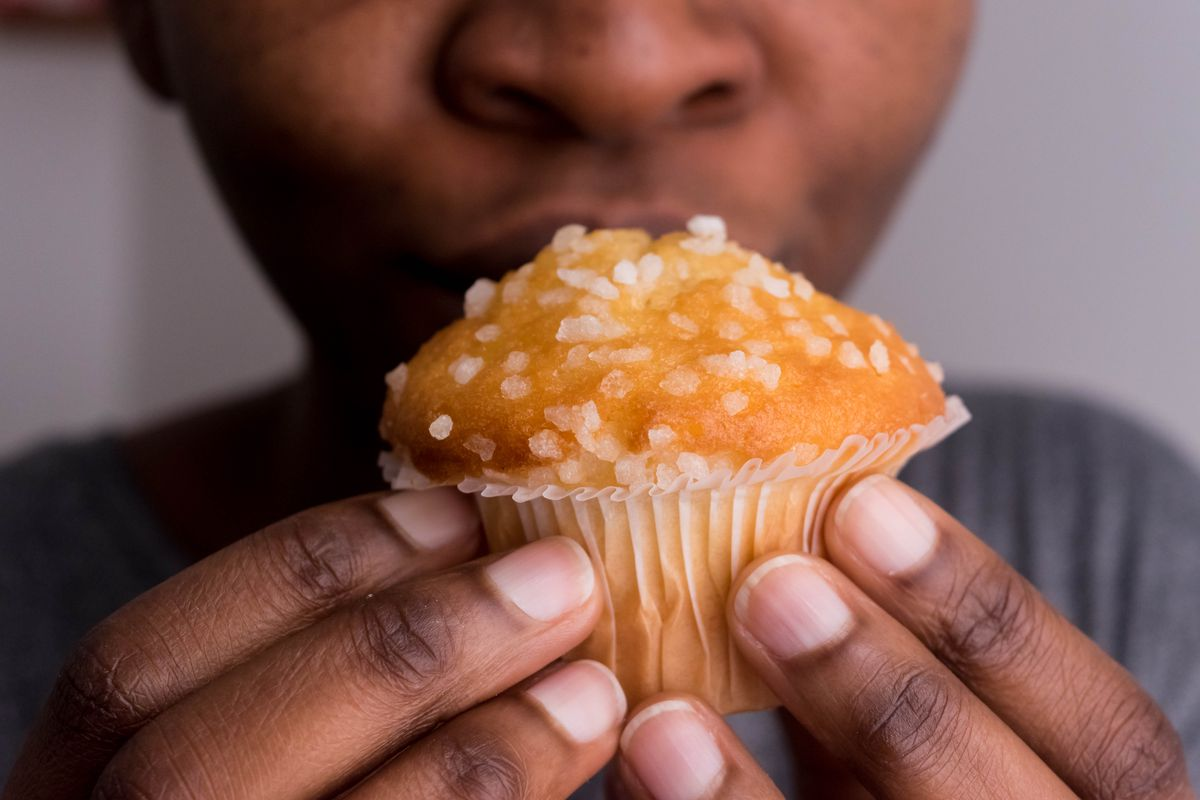 Close up of woman's hands holding a muffin