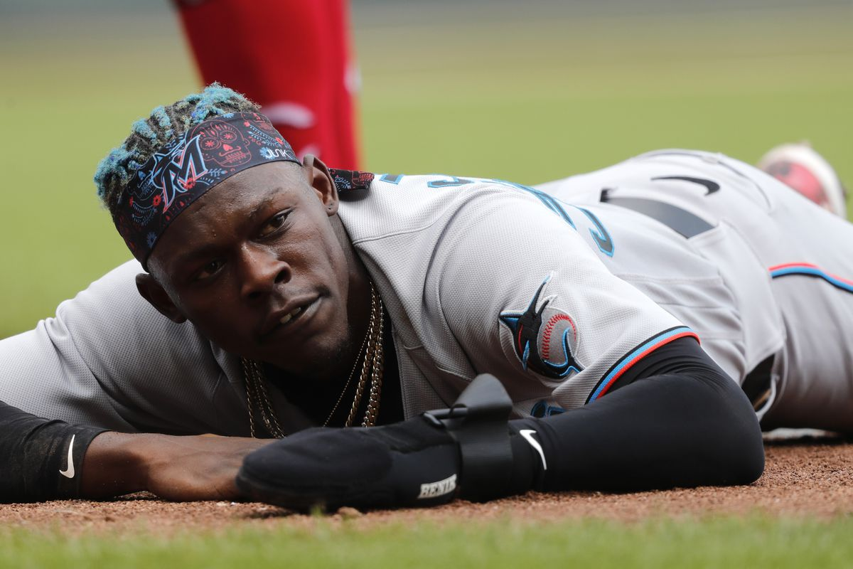 Miami Marlins second baseman Jazz Chisholm Jr. (2) reaches safely back to first base after a fly ball against the Cincinnati Reds during the fourth inning at Great American Ball Park.