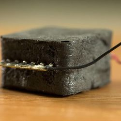 A piece of foam with nano particles conducts an electrical current when the foam is compressed.