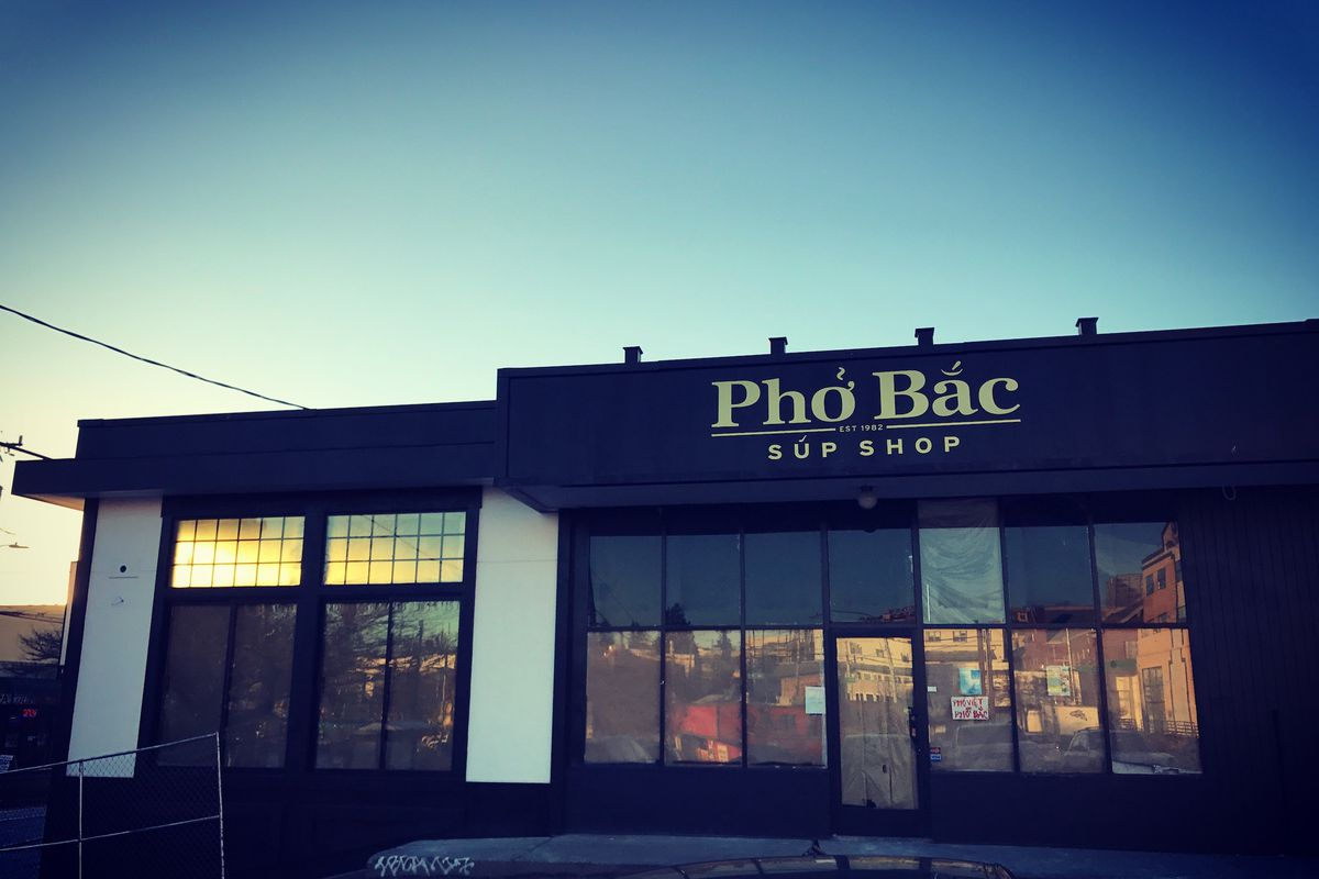 The exterior of Pho Bac Sup Shop, with the restaurant's name featured prominently above windows looking inside.