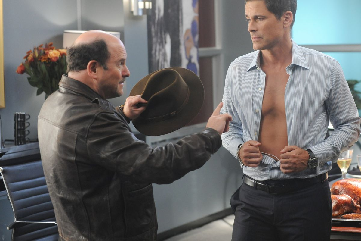 Dean (Rob Lowe, right) deals with the creator of his old TV show (Jason Alexander), who sees him mostly as a set of chiseled abs.