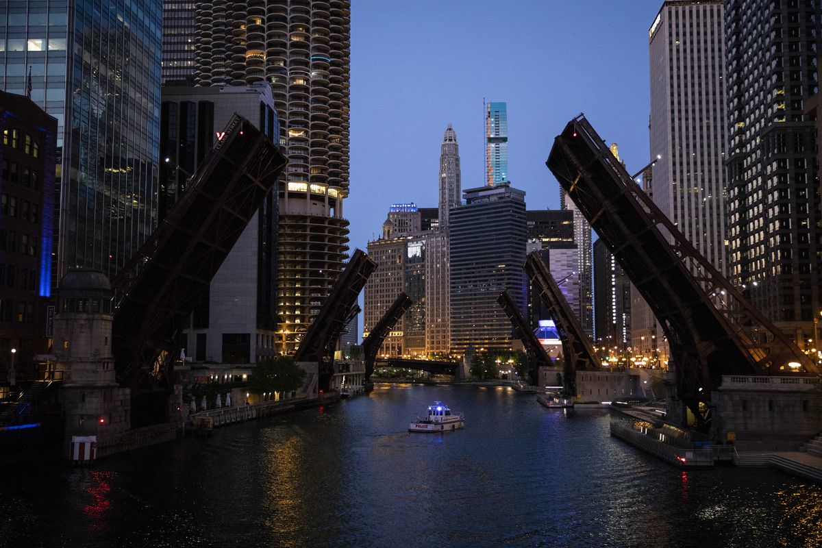 Bridges over the Chicago River were lifted to limit transportation to and from the Loop as thousands of protesters in Chicago joined national outrage over the killing of George Floyd in Minneapolis police custody, Saturday afternoon, May 30, 2020.
