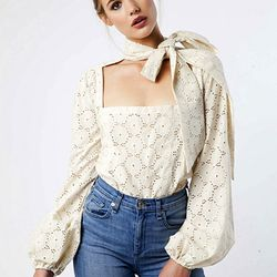 A modern twist on a classic eyelet peasant blouse.