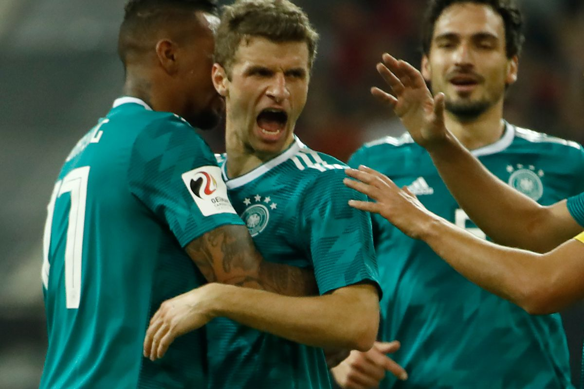 Germany's forward Thomas Mueller (2nd L) is congratulated by his teammates Germany's defender Jerome Boateng (L), Germany's defender Mats Hummels (2nd R) and Germany's midfielder Sami Khedira (R) after scoring the 1-1 during the international friendly football match of Germany vs Spain in Duesseldorf, western Germany, on March 23, 2018, in preparation of the 2018 Fifa World Cup.