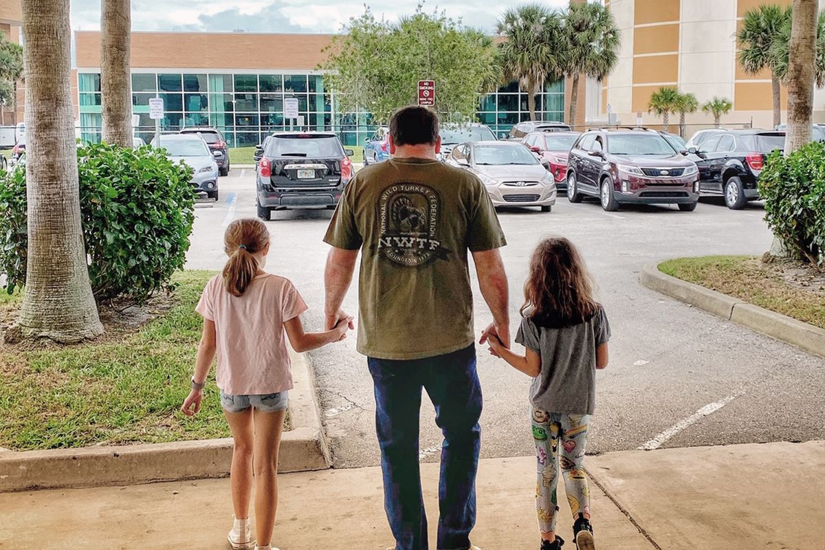 NASCAR driver Ryan Newman and his daughters, Brooklyn Sage, left, and Ashlyn Olivia, leave Halifax Medical Center in Daytona Beach, Fla., on Wednesday.