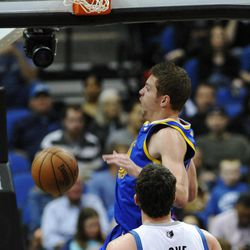 Golden State Warriors' David Lee, top, slams in two points as Minnesota Timberwolves' Kevin Love watches in the first half of an NBA basketball game on Wednesday, April 4, 2012, in Minneapolis.