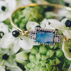 18 karat gold limited edition bangle with boulder opal and diamonds, $6,615