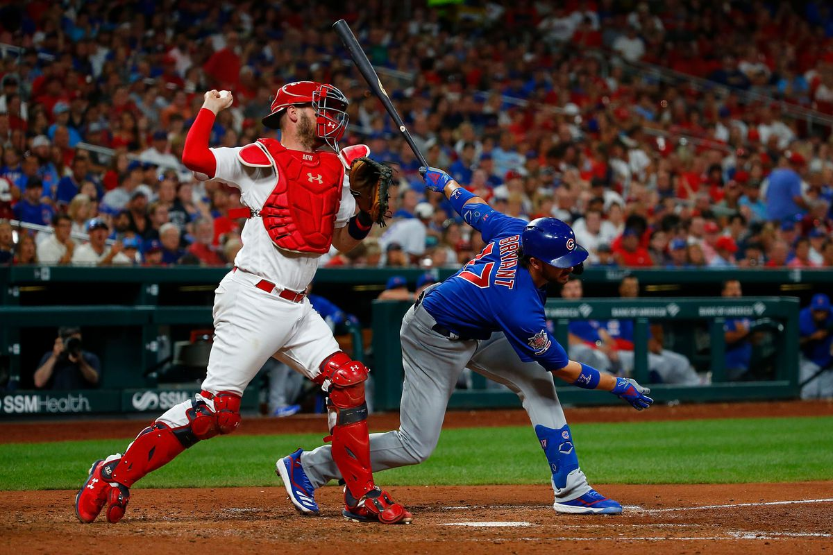 Yadier Molina makes a throw to second base after Kris Bryant swing and miss in a Cardinals vs. Chicago Cubs game.