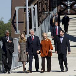 Arkansas Governor Mike Beebe, left, Chelsea Clinton, second from left, Former President Bill Clinton, center, Secretary of State Hillary Rodham Clinton, second from right, and U.S. Assistant Secretary of Commerce for Economic Development John Fernandez, right, cross a new pedestrian bridge in Little Rock, Ark. Friday Sept. 30, 2011. Former president Clinton was in town to dedicate the bridge located adjacent to his presidential library.