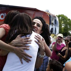 Jessica Gomez receives hugs and congratulations after being told she will have a new home for her family.