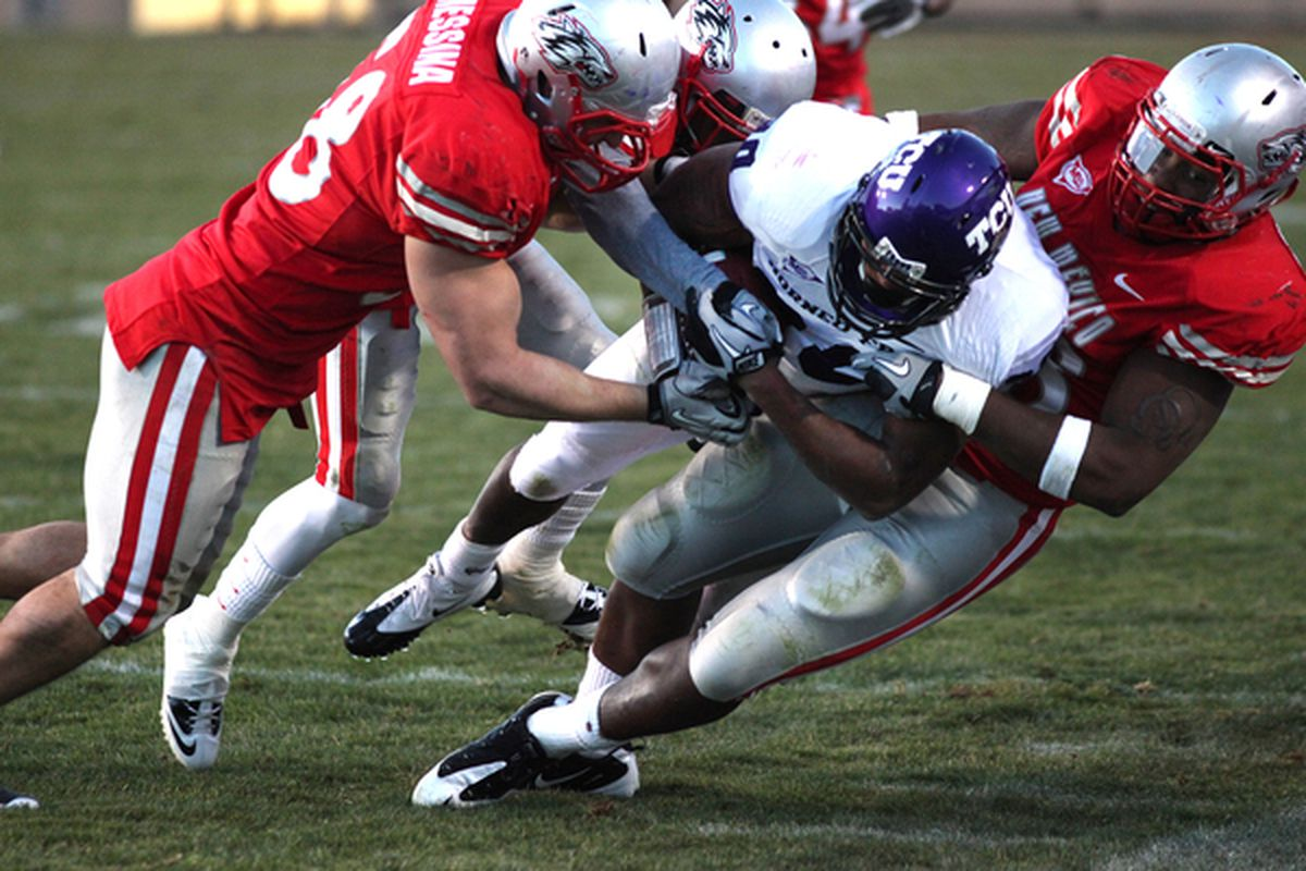 A pack of New Mexico Lobos take down a TCU Horned Frog at University Stadium in Albuquerque, New Mexico. (Photo by Eric Draper/Getty Images)