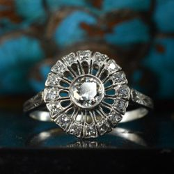 1930s diamond sunburst ring, platinum. I got this right ring from an estate. The seller's great-aunt bought it in the 1930s, and it had been in a box pretty much ever since then. It was in perfect condition.