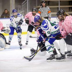 Connecticut Whale forward Meghan Huertas gets swarmed by defenders.