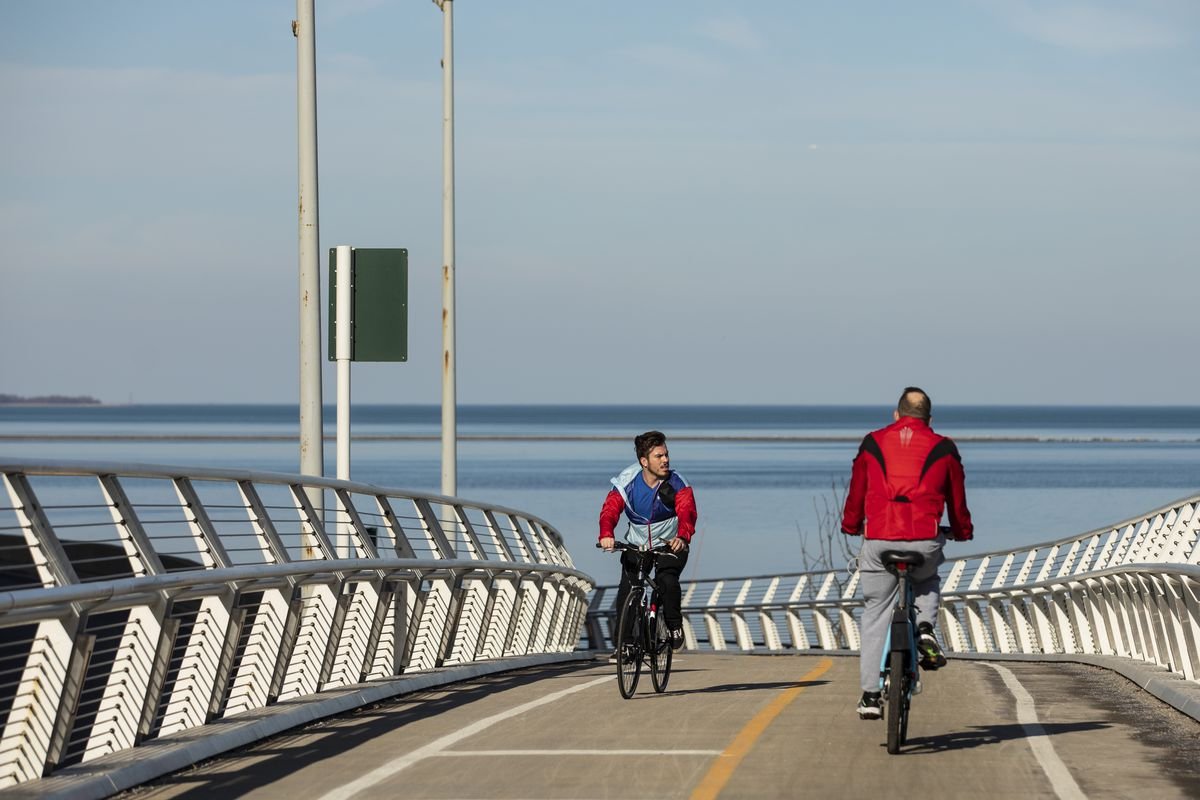 People ride bikes on the Lakefront Trail during record high temperatures for Chicago on the day after Christmas.