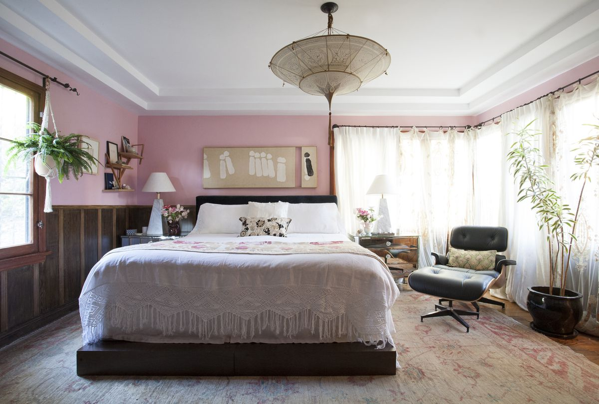 The master bedroom is painted a pale pink.