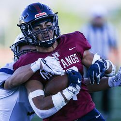 Herriman's Afa Kula (10) is brought down by the Westlake defense during a high school football game at Herriman High School in Herriman on Friday, Sept. 4, 2020.