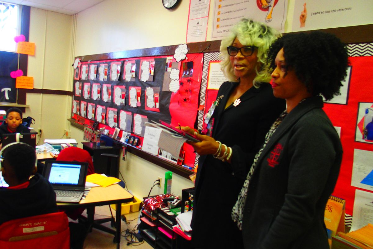 From left: Sharon Griffin, now chief of schools for Shelby County Schools, confers with Laquita Tate, principal of Ford Road Elementary, part of the Innovation Zone during a 2016 visit.