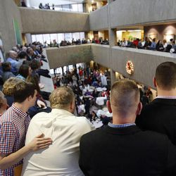 Couples wait to get marriage licenses outside the Salt Lake County clerk's office, Monday, Dec. 23, 2013. At left are Addison Rose and Todd Markham. At right are Dave Atkinson and Bobby Smith. U.S. District Judge Robert Shelby denied a motion by the state of Utah to halt same-sex marriages pending an appeal.