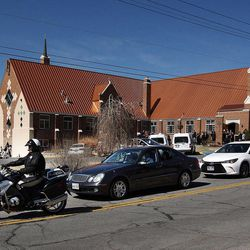 A procession leaves Wasatch Presbyterian Church in Salt Lake City, Monday, March 9, 2015 following the memorial service for Deedee Corradini.