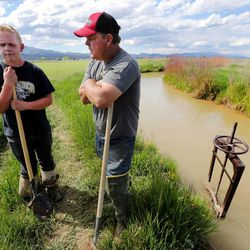Wally Dodds and his son Makoy talk Monday, June 8, 2015, in Panguitch about their feelings on the declining number of kids in school and the economic troubles of Garfield County.