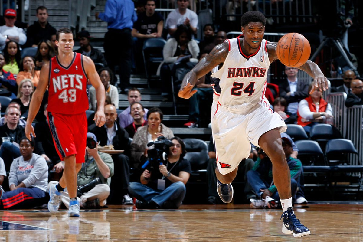 ATLANTA, GA - DECEMBER 30:  Marvin Williams #24 of the Atlanta Hawks steals a pass by the New Jersey Nets at Philips Arena on December 30, 2011 in Atlanta, Georgia.  (Photo by Kevin C. Cox/Getty Images)