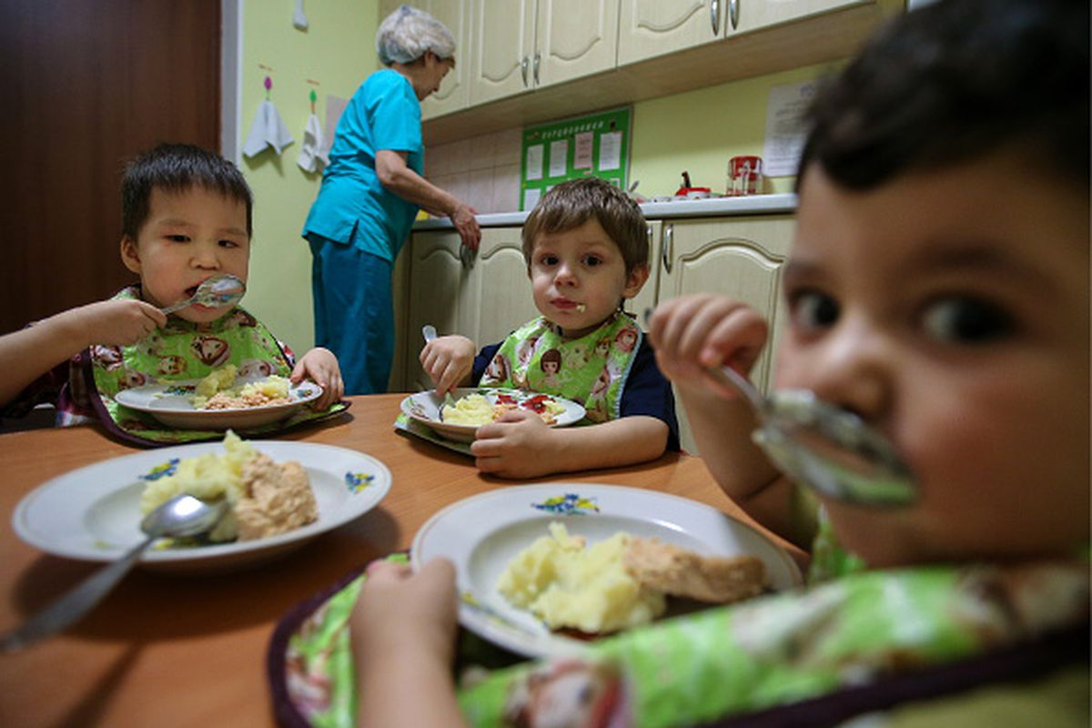 Children having supper in a dining hall at the tsentralny centre for promoting family upbringing tsssv the centre cares for babies and children aged 0 to