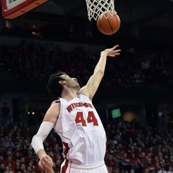 Frank Kaminsky extends for a rebound late in the Badger's 63-53 victory over the Gophers