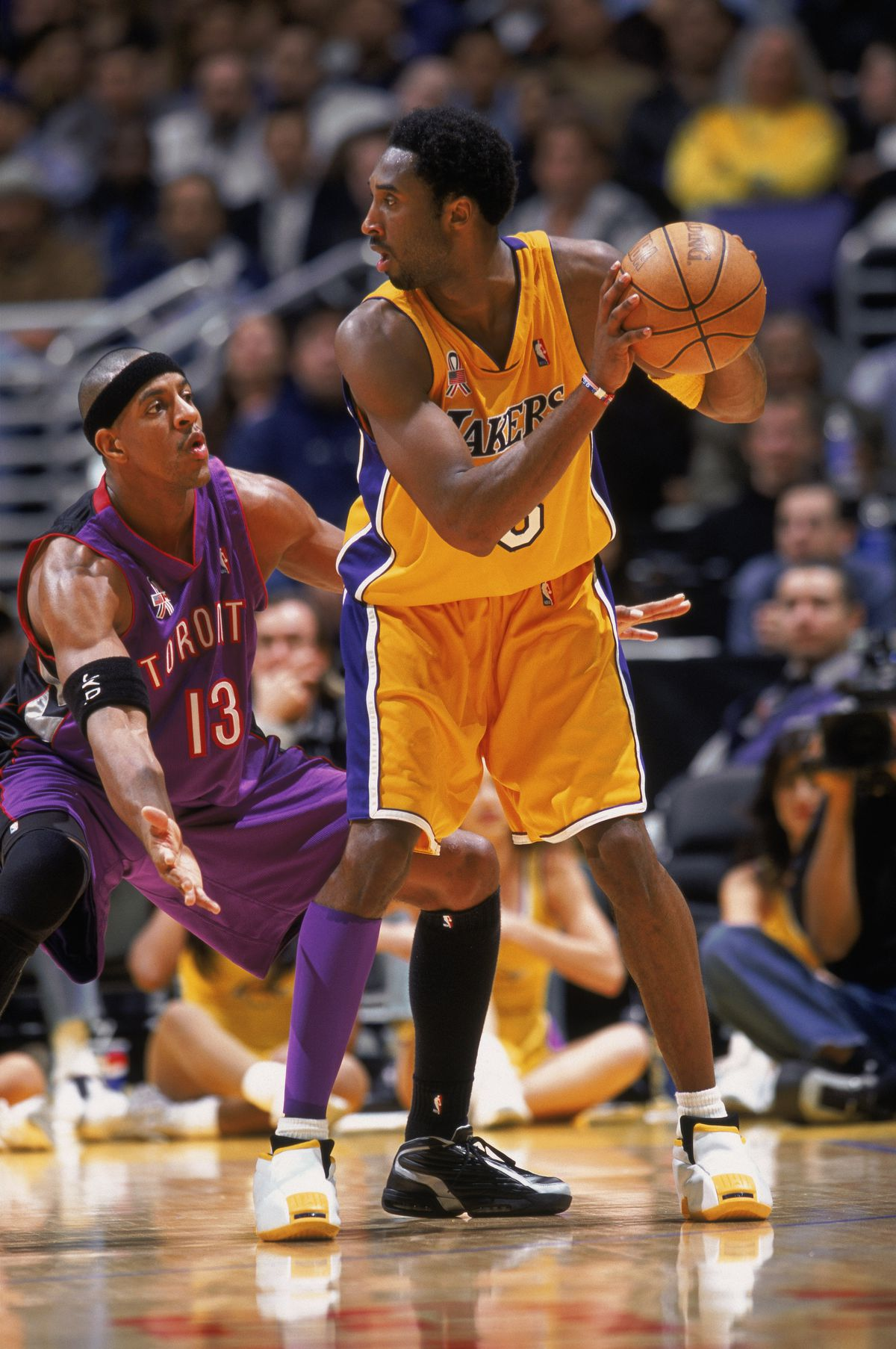 Kobe Bryant #8 of the Los Angeles Lakers holds the ball.