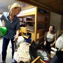Nancy Hart helps her daughter, Lauren Hart, move into her dorm at the University of Utah in Salt Lake City on Thursday, Aug. 17, 2017.