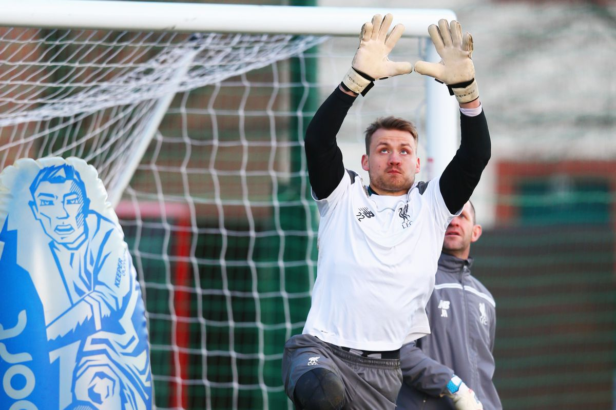 John Achterberg is the one standing to Simon Mignolet's left.