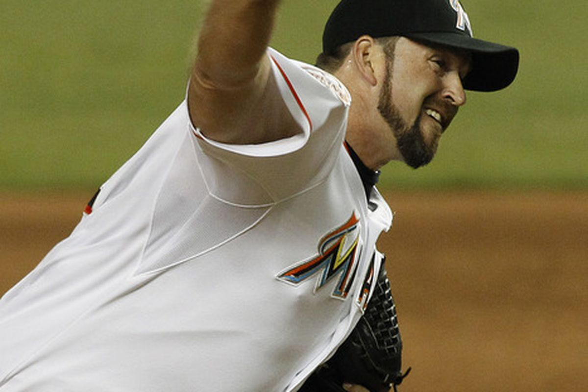 May 22, 2012; Miami, FL, USA; Miami Marlins relief pitcher Heath Bell (21) gets a save against the Colorado Rockies at Marlins Park. The Marlins defeated the Rockies 7-6. Mandatory Credit: Robert Mayer-US PRESSWIRE
