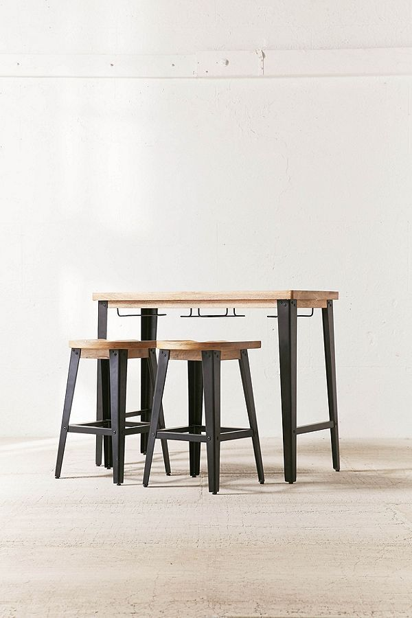 A pale wood and black metal counter height table has two matching stools.