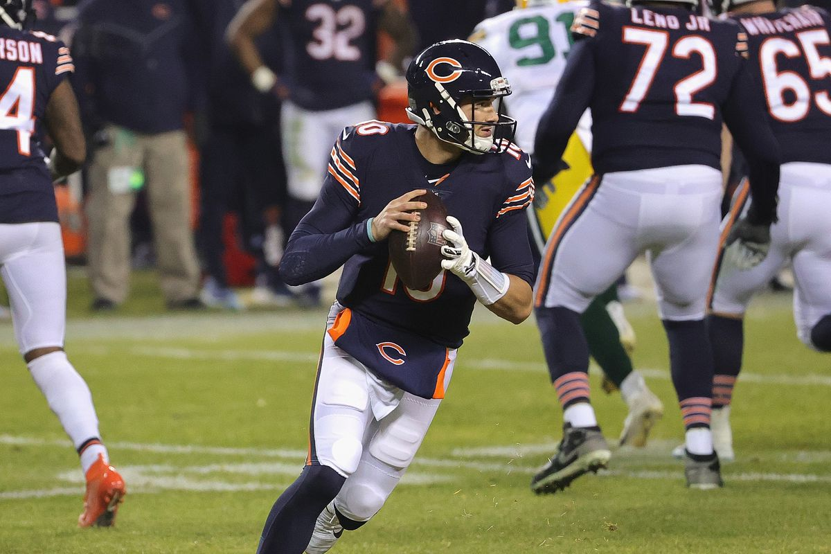 Mitchell Trubisky #10 of the Chicago Bears rolls out to look for a receiver against the Green Bay Packers at Soldier Field on January 03, 2021 in Chicago, Illinois. The Packers defeated the Bears 35-16.