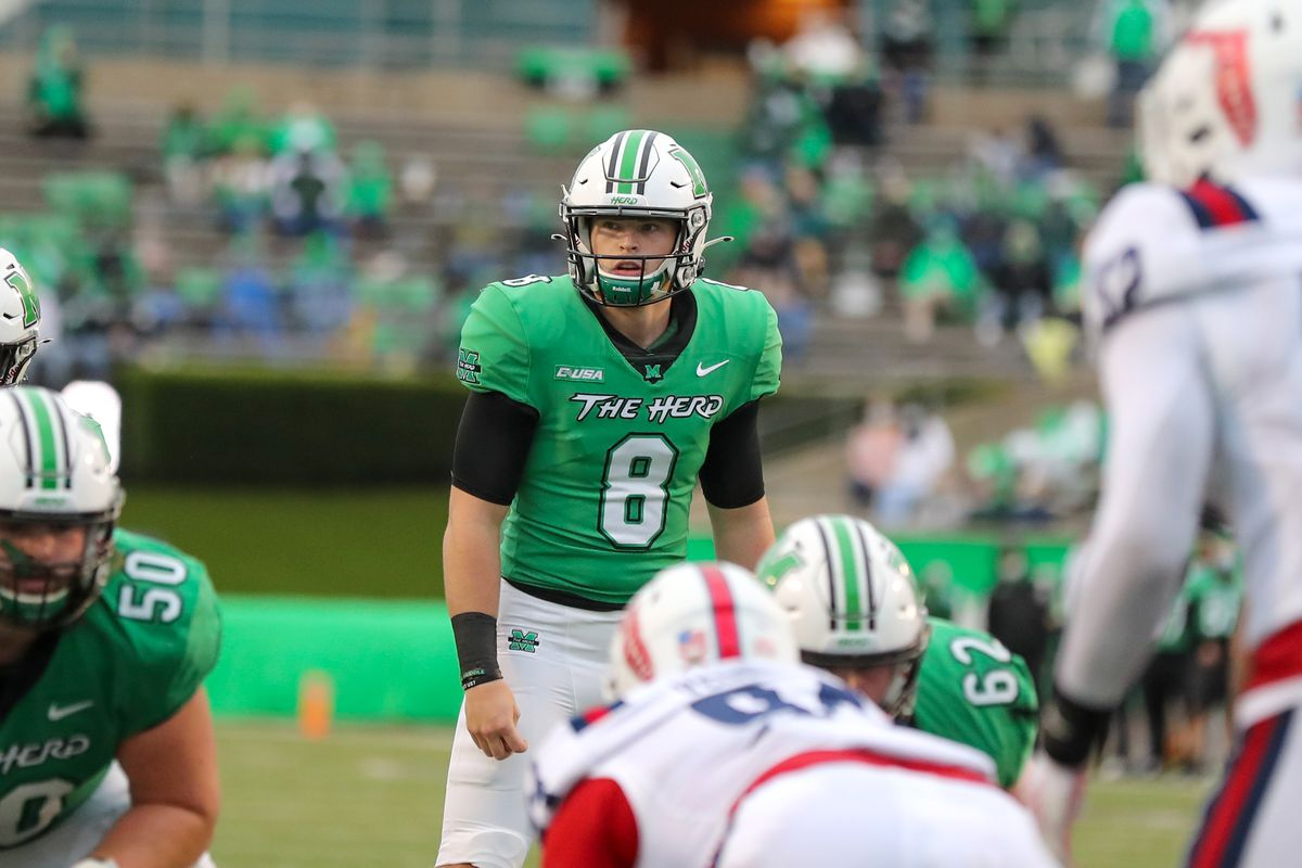 Marshall Thundering Herd quarterback Grant Wells looks over the defense during the fourth quarter of the college football game between the Florida Atlantic Owls and the Marshall Thundering Herd on October 24, 2020, at Joan C. Edwards Stadium in Huntington, WV.