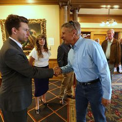 Cole LaCroix greets Libertarian presidential candidate Gov. Gary Johnson at the Alta Club as he and running mate Gov. Bill Weld visit Salt Lake City for a speech at the University of Utah on Saturday, Aug. 6, 2016.
