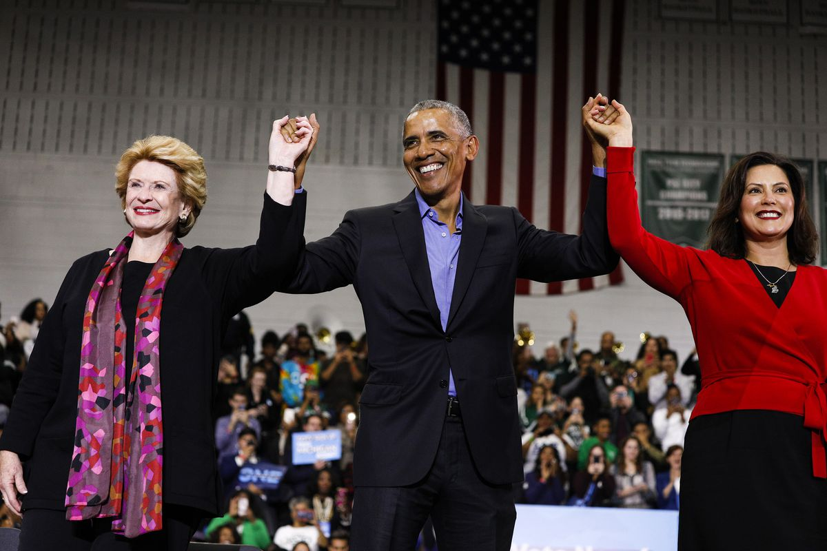 Former President Barack Obama with Michigan victors Senator Debbie Stabenow (left) and Gretchen Whitmer (right) in Detroit, Michigan, on October 26, 2018.