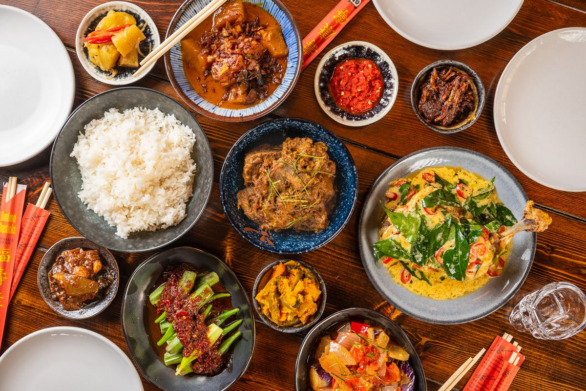 """Nasi campur, or """"with rice,"""" dishes at Makan include beef rendang, center; pajeri nenas (pineapple currry), top; ayam goreng (fried chicken with salted duck yolk andcurry leaf), right, and okra in sambal."""