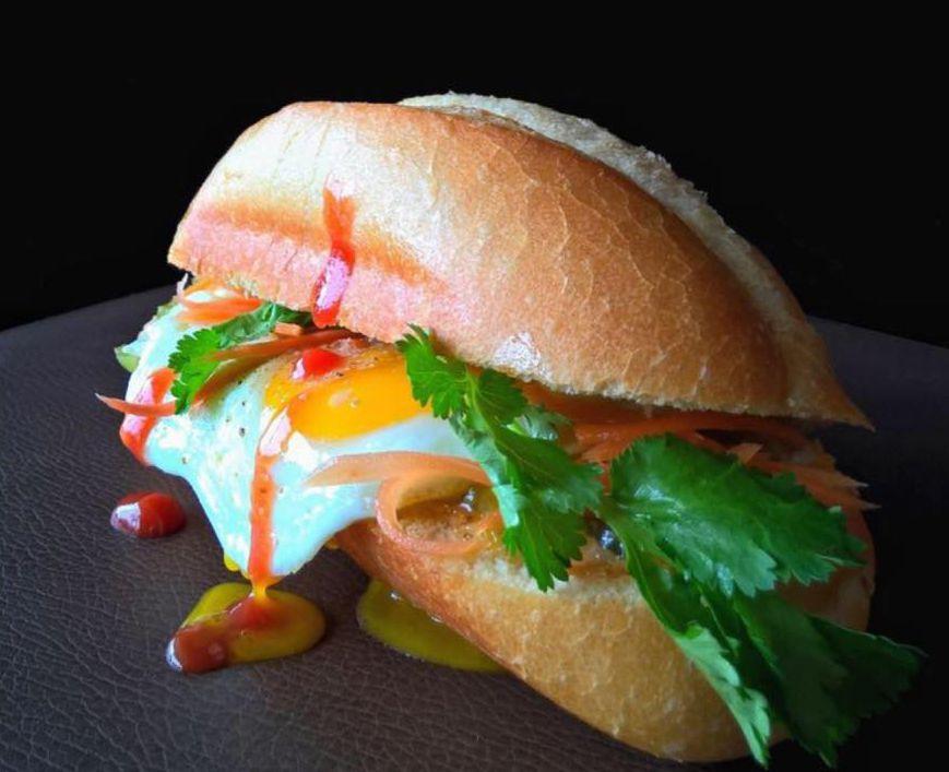 A fried egg, banh mi Vietnamese sandwich on th takeout menu at Pho Mai Mai Restaurant.