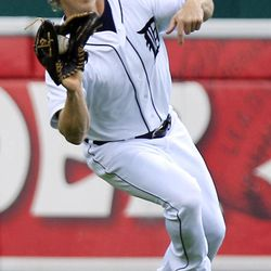 Detroit Tigers left fielder Andy Dirks makes a catch on a hit by Minnesota Twins' Eduardo Escobar during the first inning of a baseball game in Detroit, Sunday, Sept. 23, 2012.