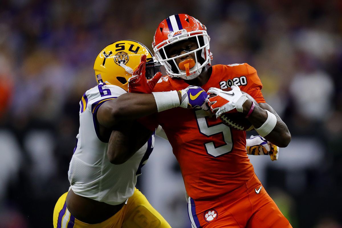 Jacob Phillips of the LSU Tigers tackles Tee Higgins of the Clemson Tigers during the first half in the College Football Playoff National Championship game at Mercedes Benz Superdome on January 13, 2020 in New Orleans, Louisiana.