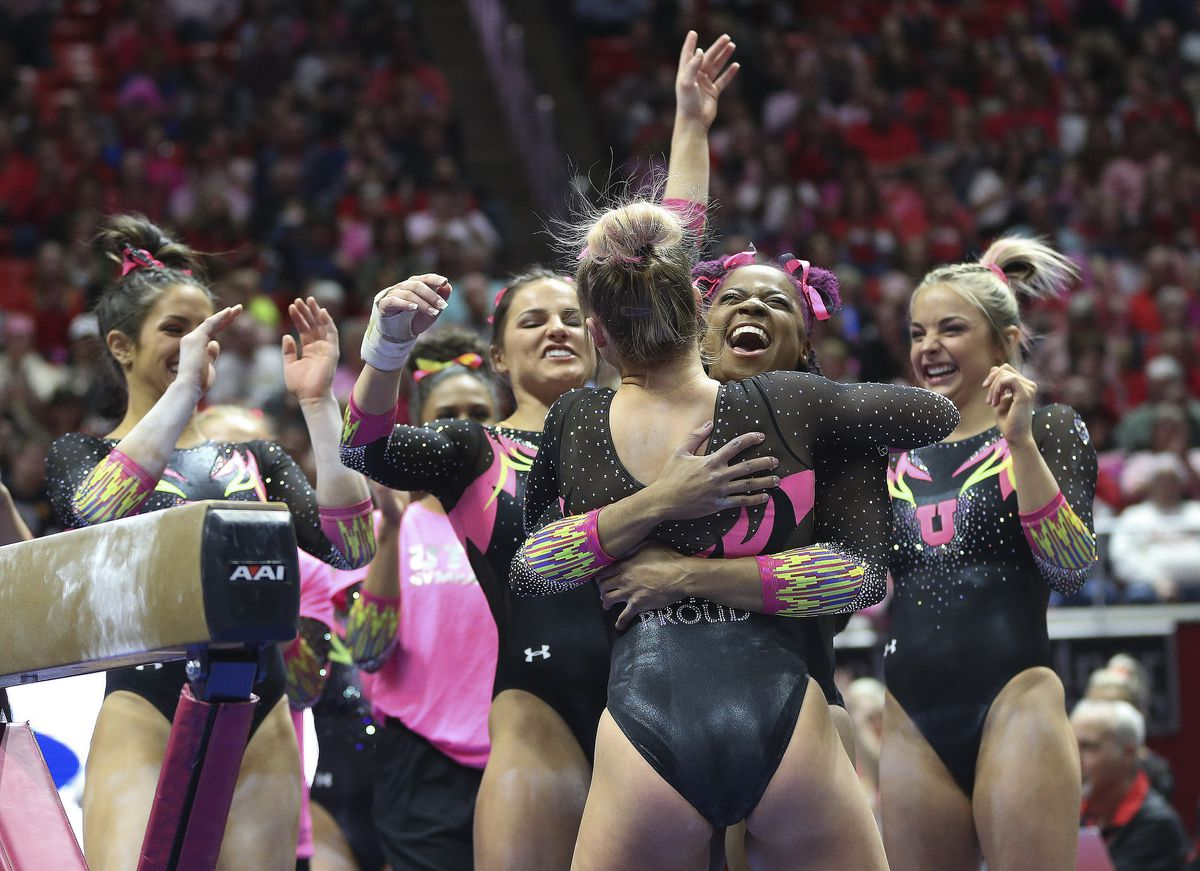 University of Utah gymnast Abby Paulson is congratulated after competing on the beam in Salt Lake City on Friday, March 6, 2020.