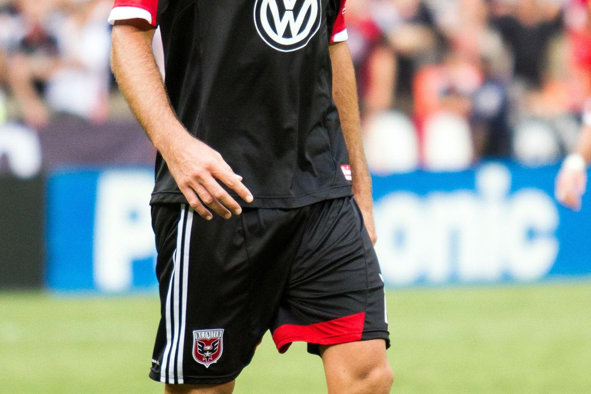 Aug 19, 2012; Washington, DC, USA; DC United defender Emiliano Dudar (19) walks off the field after a red card against Philadelphia Union during the second half at RFK Stadium.  Mandatory Credit: Paul Frederiksen-US PRESSWIRE