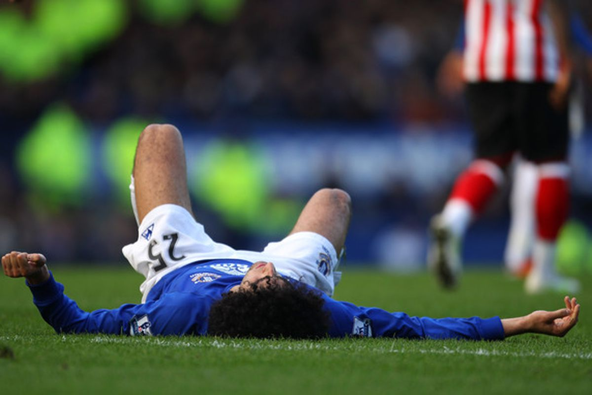 LIVERPOOL, ENGLAND - FEBRUARY 26:  Marouane Fellaini of Everton lies injured during the Barclays Premier League match between Everton and Sunderland at Goodison Park on February 26, 2011 in Liverpool, England.  (Photo by Alex Livesey/Getty Images)