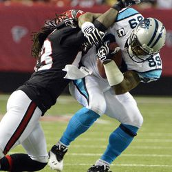 Atlanta Falcons cornerback Dunta Robinson (23) stops Carolina Panthers wide receiver Steve Smith (89) during the first half of an NFL football game Sunday, Sept. 30, 2012, in Atlanta.